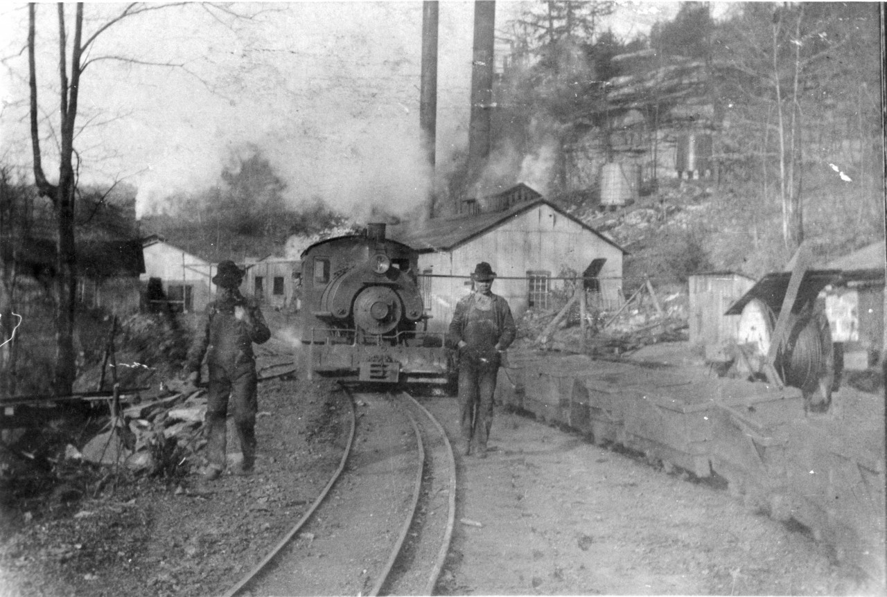 Dunlap Mines Fredonia Mtn coal mine Dinky Locomotive enroute to Incline with full coal  mine cars and Robert Davis on right  mine number two065